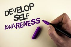 Conceptual hand writing showing Develop Self Awareness. Business photo showcasing What you think you become motivate and grow writ. Ten by Man plain background Royalty Free Stock Images
