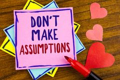 Conceptual hand writing showing Do not Make Assumptions. Business photo text predict events future without clue Alternative Facts. Written Sticky note paper stock image