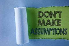 Conceptual hand writing showing Do not Make Assumptions. Business photo text predict events future without clue Alternative Facts. Written under Tear Folded royalty free stock photos