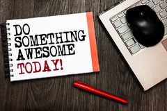 Conceptual hand writing showing Do Something Awesome Today. Business photo showcasing Make an incredible action motivate yourself. Bluetooth mouse on keyboard Stock Photo
