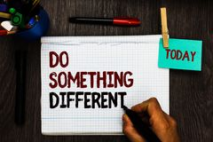 Conceptual hand writing showing Do Something Different. Business photo text be unique Think outside of the box Have some fun Regis. Ter pages handwriting text royalty free stock image