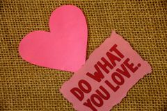 Conceptual hand writing showing Do What You Love.. Business photo text Positive Desire Happiness Interest Pleasure Happy Choice Te. Xt pink torn paper note heart stock images