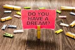 Conceptual hand writing showing Do You Have A Dream question. Business photo text asking someone about life goals Achievements Cli. Ps spread woody table learn royalty free stock images