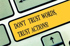 Conceptual hand writing showing Don T Trust Words Trust Actions. Business photo text Less talking more things done. Action taken Keyboard key Intention to royalty free stock images