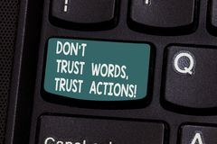 Conceptual hand writing showing Don T Trust Words Trust Actions. Business photo text Less talking more things done. Action taken Keyboard key Intention to stock photo