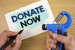 Conceptual hand writing showing Donate Now. Business photo showcasing Give something to charity Be an organ donor Help others. Con. Conceptual hand writing stock image