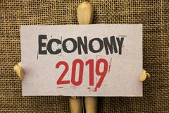 Conceptual hand writing showing Economy 2019. Business photo text Financial Currency Growth Market Earnings Trade Money written on. Conceptual hand writing Royalty Free Stock Image