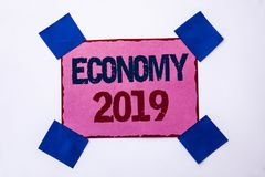 Conceptual hand writing showing Economy 2019. Business photo text Financial Currency Growth Market Earnings Trade Money written on. Conceptual hand writing Stock Photos
