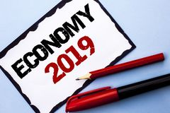 Conceptual hand writing showing Economy 2019. Business photo text Financial Currency Growth Market Earnings Trade Money written on. Conceptual hand writing Stock Photo