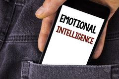 Conceptual hand writing showing Emotional Intelligence. Business photo text Capacity to control and be aware of personal emotions. Written Mobile Phone holding royalty free stock photos