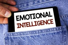 Conceptual hand writing showing Emotional Intelligence. Business photo text Capacity to control and be aware of personal emotions. Written Mobile phone holding stock photography