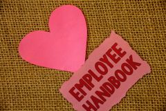 Conceptual hand writing showing Employee Handbook. Business photo text Document Manual Regulations Rules Guidebook Policy Code Tex. T pink torn paper note heart royalty free stock photos