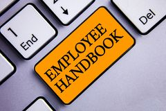 Conceptual hand writing showing Employee Handbook. Business photo text Document Manual Regulations Rules Guidebook Policy Code Tex. T two words orange insert stock photography