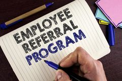 Conceptual hand writing showing Employee Referral Program. Business photo showcasing Recommend right jobseeker share vacant job po. St written by Man Notebook stock photo