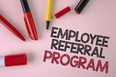 Conceptual hand writing showing Employee Referral Program. Business photo text Recommend right jobseeker share vacant job post wri. Tten plain Pink background stock photography