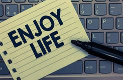 Conceptual hand writing showing Enjoy Life. Business photo showcasing Any thing, place,food or person, that makes you relax and ha. Ppy Notebook paper keyboard stock images