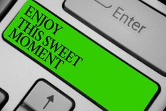Conceptual hand writing showing Enjoy This Sweet Moment. Business photo showcasing encouraging someone to love his life timeline K. Eyboard green key computer Royalty Free Stock Photos
