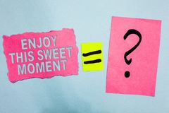 Conceptual hand writing showing Enjoy This Sweet Moment. Business photo showcasing encouraging someone to love his life timeline P. Ink paper equal sign question Royalty Free Stock Photography