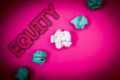 Conceptual hand writing showing Equity. Business photo text Value of a company divided into equal parts owned by shareholders Idea. S messages pink background stock image