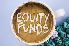Conceptual hand writing showing Equity Funds. Business photo showcasing Investors enjoys great benefits with long term investment. Written Coffee in Cup plain Stock Image