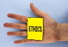 Conceptual hand writing showing Ethics. Business photo showcasing Maintaining equality balance among others having moral principle. S written Yellow Sticky Note Stock Photo