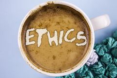 Conceptual hand writing showing Ethics. Business photo showcasing Maintaining equality balance among others having moral principle. S written Coffee in Cup plain Stock Photography