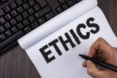 Conceptual hand writing showing Ethics. Business photo text Maintaining equality balance among others having moral principles writ. Ten by Marker in Hand Royalty Free Stock Image