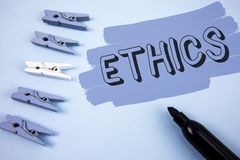 Conceptual hand writing showing Ethics. Business photo text Maintaining equality balance among others having moral principles writ. Ten Painted background wooden Royalty Free Stock Image