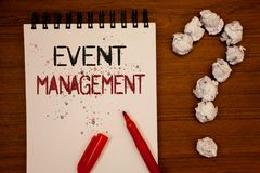 Conceptual hand writing showing Event Management. Business photo showcasing Special Occasion Schedule Organization Arrange Activit. Ies Ideas on notebook wooden royalty free stock photo