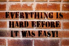 Conceptual hand writing showing Everything Is Hard Before It Was Easy. Business photo text First steps are harder. Inspiration stock photos