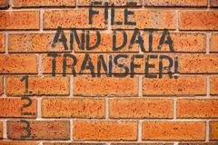 Conceptual hand writing showing File And Data Transfer. Business photo showcasing Transferring information online by the. Internet stock images