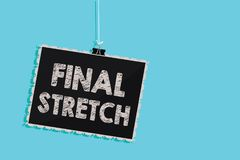 Conceptual hand writing showing Final Stretch. Business photo showcasing Last Leg Concluding Round Ultimate Stage Finale Year ende. R Hanging blackboard message stock illustration