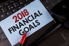 Conceptual hand writing showing 2018 Financial Goals. Business photo showcasing New business strategy earn more profits less inves. Tment written Sticky Note Royalty Free Stock Photos