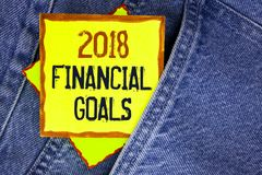 Conceptual hand writing showing 2018 Financial Goals. Business photo showcasing New business strategy earn more profits less inves. Tment written Yellow Sticky Stock Photography