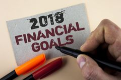 Conceptual hand writing showing 2018 Financial Goals. Business photo text New business strategy earn more profits less investment. Written by Man with Marker Royalty Free Stock Photos