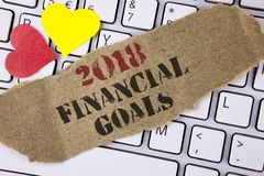 Conceptual hand writing showing 2018 Financial Goals. Business photo text New business strategy earn more profits less investment. Written Tear Cardboard Piece Stock Photos