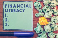 Conceptual hand writing showing Financial Literacy. Business photo showcasing Understand and knowledgeable on how money works.  stock image