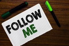 Conceptual hand writing showing Follow Me. Business photo text Inviting a person or group to obey your prefered leadership Noteboo. K paper markers wooden royalty free stock photography