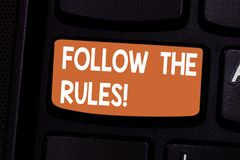 Conceptual hand writing showing Follow The Rules. Business photo showcasing act in agreement or compliance with obey. Them Firmly Keyboard key Intention to stock images