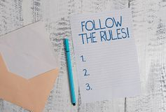 Conceptual hand writing showing Follow The Rules. Business photo showcasing go with regulations governing conduct or. Conceptual hand writing showing Follow The royalty free stock images
