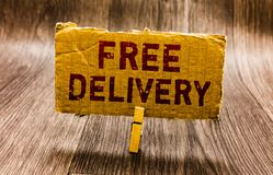 Conceptual hand writing showing Free Delivery. Business photo text Shipping Package Cargo Courier Distribution Center Fragile Pape. R notes reminders question stock photos