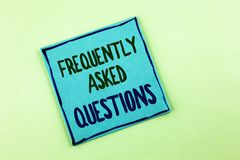 Conceptual hand writing showing Frequently Asked Questions. Business photo showcasing most common inquiries Informations Help Guid. E written Sticky Note Paper Stock Photo