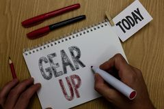 Conceptual hand writing showing Gear Up. Business photo showcasing Asking someone to put his clothes or suit on Getting. Ready fast Man holding marker notebook royalty free stock image