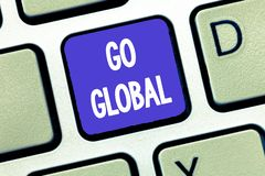 Conceptual hand writing showing Go Global. Business photo showcasing relating to or encompassing whole something or stock image