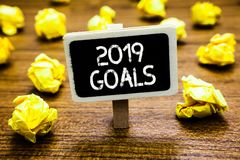 Conceptual hand writing showing 2019 Goals. Business photo showcasing A plan to do for something new and better for the coming yea. R Blackboard crumpled paper stock image