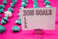 Conceptual hand writing showing 2018 Goals 1. 2. 3.. Business photo showcasing Resolution Organize Beginnings Future Plans Papercl. Ip with pink letters pink stock images