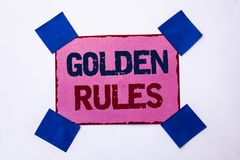 Conceptual hand writing showing Golden Rules. Business photo text Regulation Principles Core Purpose Plan Norm Policy Statement wr. Itten Pink Sticky Note Paper stock photography