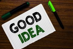 Conceptual hand writing showing Good Idea. Business photo text State of human brain to bring great intelegence towards something N. Otebook paper markers wooden royalty free stock images