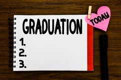 Conceptual hand writing showing Graduation. Business photo text Receiving or conferring of academic degree diploma stock photography