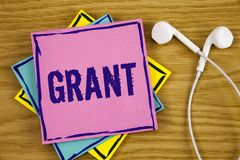 Conceptual hand writing showing Grant. Business photo showcasing Money given by an organization or government for a purpose Schola. Rship written Sticky Note Stock Photos